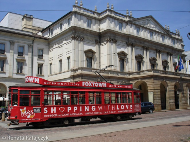 A streetcar in frond of La Scala Opera, Milan, Italy.
