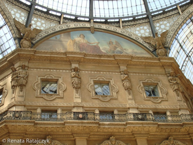 Allegoric paintings and sculptures under the dome of Galleria Vittorio Emanuele II, Milan, Italy.